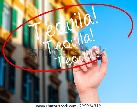 Man Hand writing Tequila with black marker on visual screen. Isolated on city. Business, technology, internet concept. Stock Photo - stock photo
