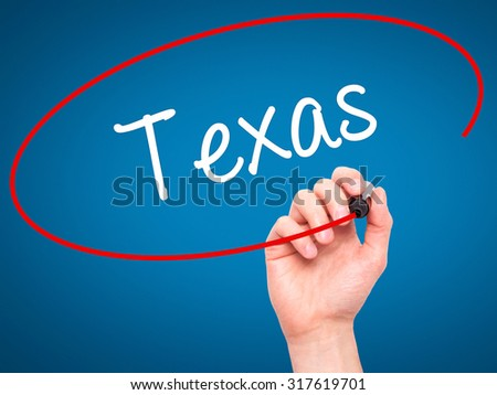 Man Hand writing Texas  with black marker on visual screen. Isolated on blue. Business, technology, internet concept. - stock photo