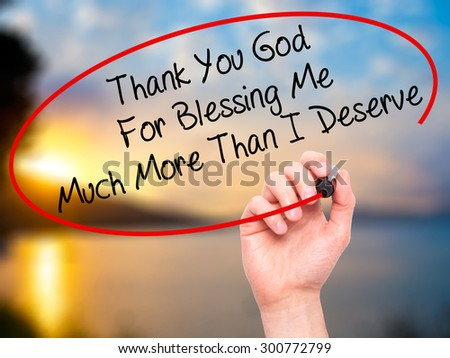 Man Hand writing Thank You God For Blessing Me Much More Than I Deserve with black marker on visual screen. Isolated on nature. Business, technology, internet concept. Stock Photo - stock photo