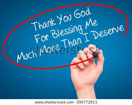 Man Hand writing Thank You God For Blessing Me Much More Than I Deserve with black marker on visual screen. Isolated on blue. Business, technology, internet concept. Stock Photo - stock photo