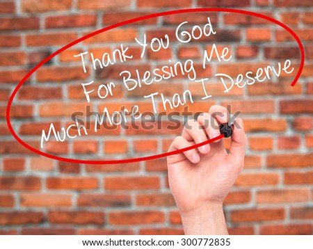 Man Hand writing Thank You God For Blessing Me Much More Than I Deserve with black marker on visual screen. Isolated on bricks. Business, technology, internet concept. Stock Photo - stock photo