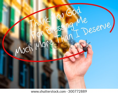 Man Hand writing Thank You God For Blessing Me Much More Than I Deserve with black marker on visual screen. Isolated on city. Business, technology, internet concept. Stock Photo - stock photo