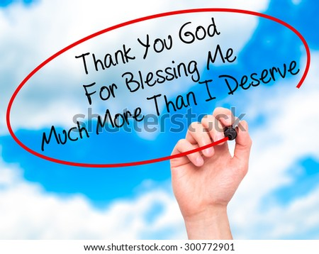 Man Hand writing Thank You God For Blessing Me Much More Than I Deserve with black marker on visual screen. Isolated on sky. Business, technology, internet concept. Stock Photo - stock photo
