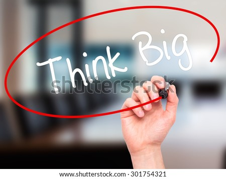 Man Hand writing Think Big with black marker on visual screen. Isolated on office. Business, technology, internet concept. Stock Photo - stock photo