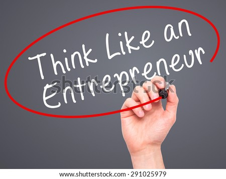 Man Hand writing Think Like an Entrepreneur with black marker on visual screen. Isolated on grey. Business, technology, internet concept. Stock Image - stock photo