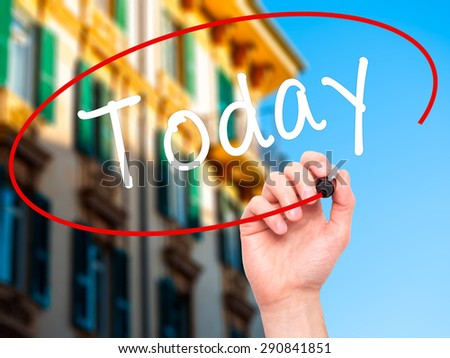 Man Hand writing Today with black marker on visual screen. Isolated on city. Business, technology, internet concept. Stock Image - stock photo