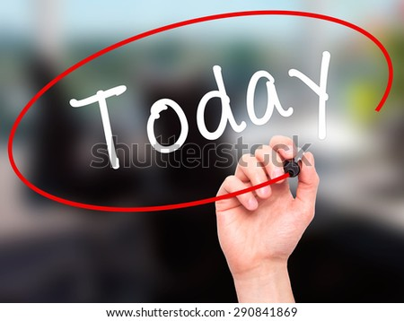 Man Hand writing Today with black marker on visual screen. Isolated on office. Business, technology, internet concept. Stock Image - stock photo
