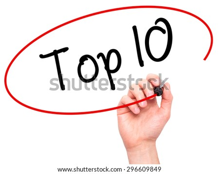 Man Hand writing Top 10 with black marker on visual screen. Isolated on white. Business, technology, internet concept. Stock Photo - stock photo
