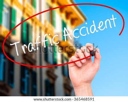 Man Hand writing Traffic Accident with black marker on visual screen. Isolated on background. Business, technology, internet concept. Stock Photo - stock photo