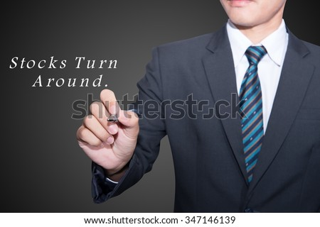 Man Hand writing Turnaround with black marker on visual screen. Isolated on black. Business, technology, internet concept. Stock Photo  - stock photo