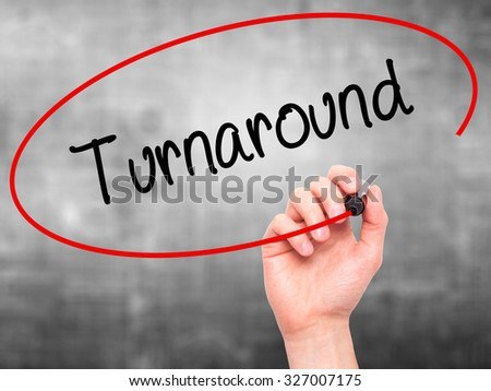 Man Hand writing Turnaround with black marker on visual screen. Isolated on grey. Business, technology, internet concept. Stock Photo - stock photo