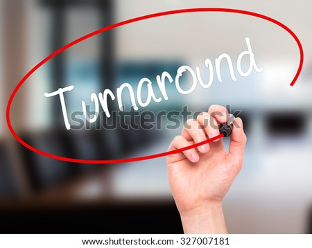 Man Hand writing Turnaround with black marker on visual screen. Isolated on office. Business, technology, internet concept. Stock Photo - stock photo