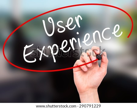 Man Hand writing User Experience with black marker on visual screen. Isolated on office. Business, technology, internet concept. Stock Image - stock photo
