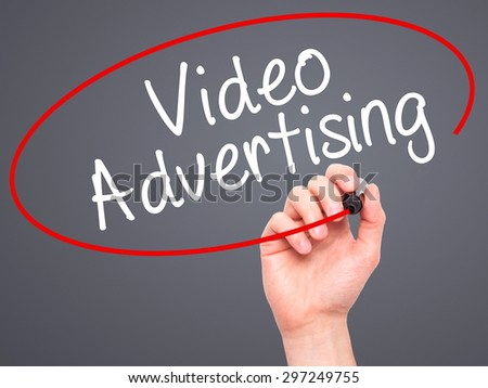 Man Hand writing Video Advertising with black marker on visual screen. Isolated on grey. Business, technology, internet concept. Stock Photo - stock photo