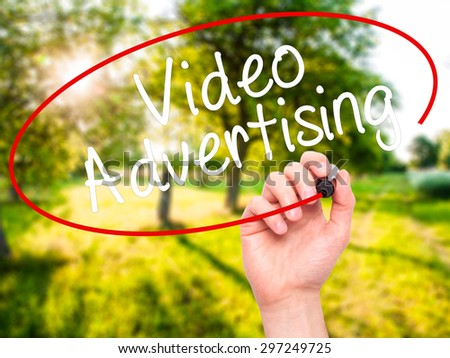 Man Hand writing Video Advertising with black marker on visual screen. Isolated on nature. Business, technology, internet concept. Stock Photo - stock photo