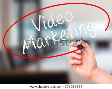 Man Hand writing Video Marketing black marker on visual screen. Isolated on office. Business, technology, internet concept. Stock Image - stock photo