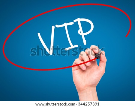 Man Hand writing  VIP with black marker on visual screen. Isolated on background. Business, technology, internet concept. Stock Photo