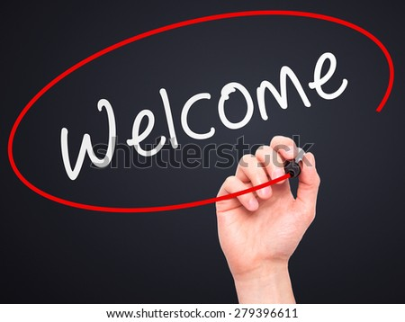 Man Hand writing Welcome with marker on transparent wipe board. Isolated on black. Business, internet, technology concept. Stock Photo - stock photo