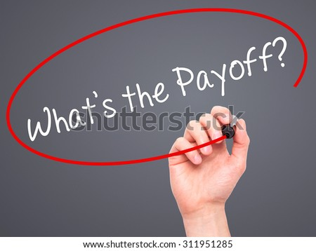 Man Hand writing What's the Payoff? with black marker on visual screen. Isolated on grey. Business, technology, internet concept. Stock Photo