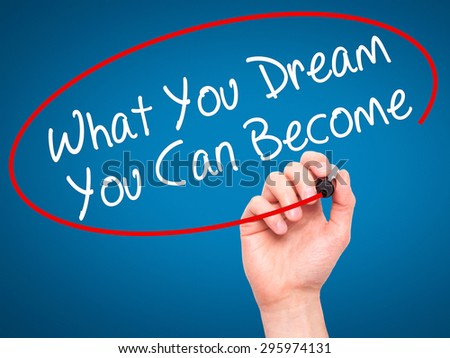 Man Hand writing What You Dream You Can Become with black marker on visual screen. Isolated on blue. Business, technology, internet concept. Stock Photo - stock photo