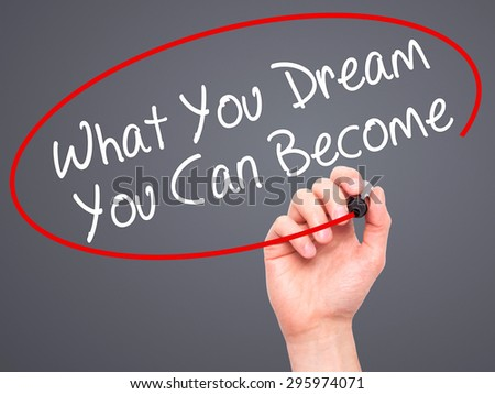 Man Hand writing What You Dream You Can Become with black marker on visual screen. Isolated on grey. Business, technology, internet concept. Stock Photo - stock photo