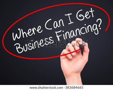 Man Hand writing Where Can I Get Business Financing? with black marker on visual screen. Isolated on background. Business, technology, internet concept. Stock Photo