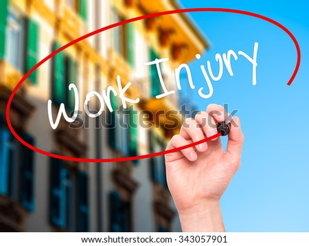 Man Hand writing Work Injury with black marker on visual screen. Isolated on city. Business, technology, internet concept. Stock Photo - stock photo
