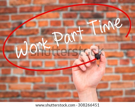 Man Hand writing Work Part Time with black marker on visual screen. Isolated on bricks. Business, technology, internet concept. Stock Photo  - stock photo