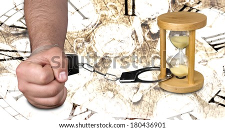 Man handcuffed to an hourglass - stock photo