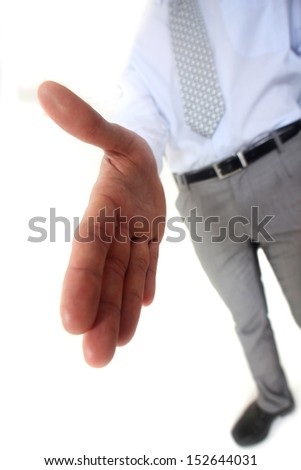 Man handing out hand - stock photo