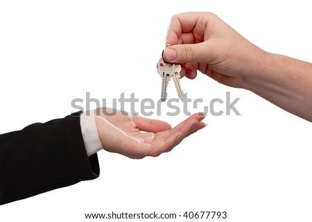 Man Handing Over Woman Set of Keys Isolated on a White Background. - stock photo