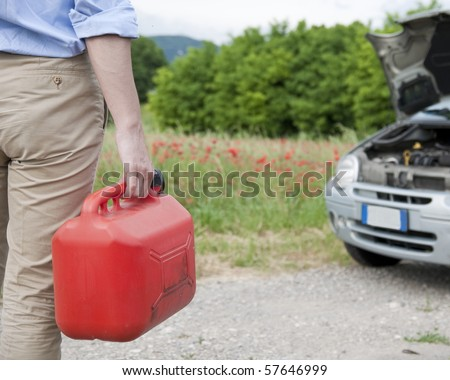 man handling a fuel tank - stock photo