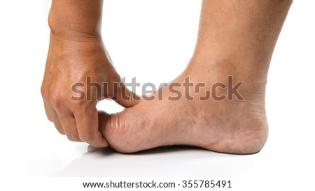 Man hands are squeezing the toes to wake topical pain from his injuries on white background.