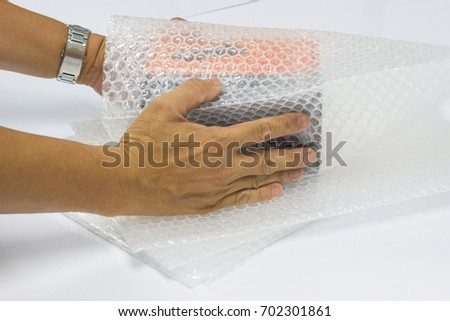 Man hands bubble wrap, product protection covering insurance, Anti-fracture damaged during shipping.