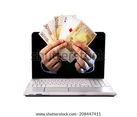 man hands coming out computer screen holding euro banknotes and ace poker playing cards in online or on line and  internet casino gambling and bets concept isolated on white background - stock photo