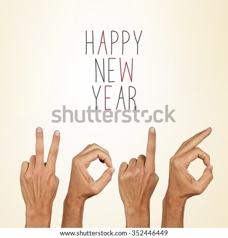 man hands forming the number 2016, as the new year, and the text happy new year on a beige background