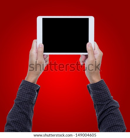 Man hands hold digital tablet isolated on red background wite clipping path - stock photo