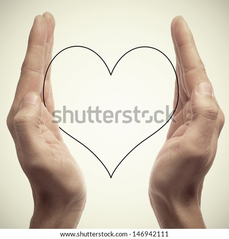 man hands holding a silhouette of a heart, with a retro effect - stock photo