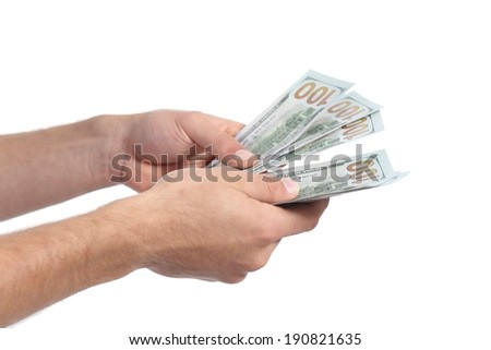 Man hands holding and counting money isolated on a white background - stock photo