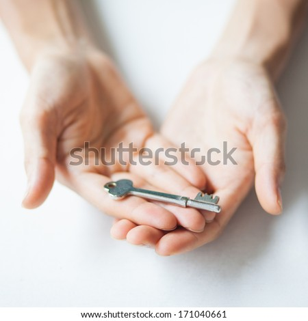Man hands holding key on white
