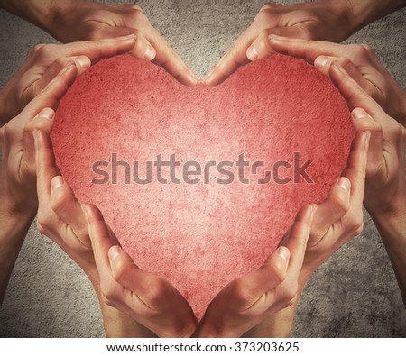 Man hands make heart shape arranged on a gray background. Healthcare concept - stock photo