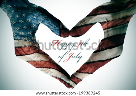 man hands patterned with the flag of the United States forming a heart and the sentence happy 4th of july - stock photo