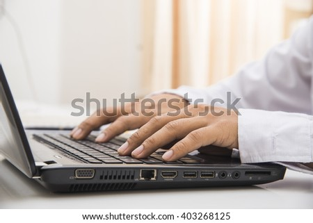 Man hands print on the laptop - stock photo