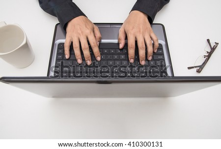 Man hands print on the laptop. - stock photo
