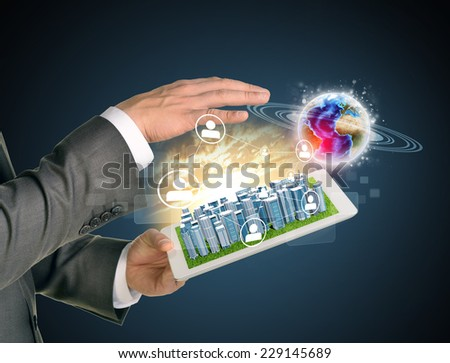 Man hands using tablet pc. Business city on touch screen. Earth with network near computer. Elements of tgis image furnished by NASA