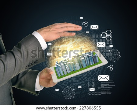Man hands using tablet pc. Business city on touch screen. Figures as backdrop.  Business concept