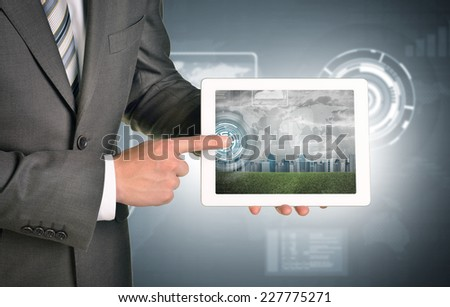 Man hands using tablet. Virtual elements and city on touchscreen. Technology concept - stock photo