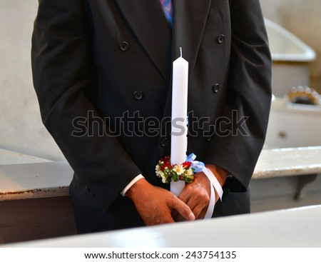 Man Hands with candle in church - stock photo