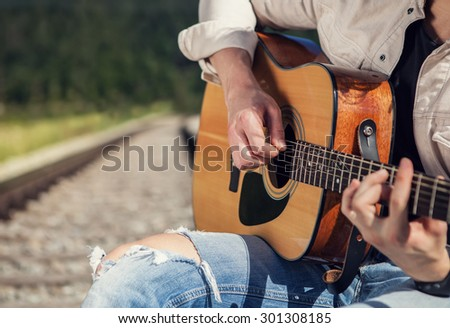 Man hands with guitar close up image - stock photo