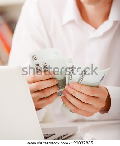 man hands with money, euro notes - stock photo